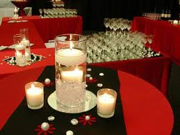 red black and gold themed centerpieces