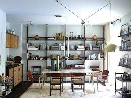 industrial inspired furniture. Industrial Inspired Furniture Sleek Lighting Hangs In The Dining Room Of Apartment Photo By Vintage