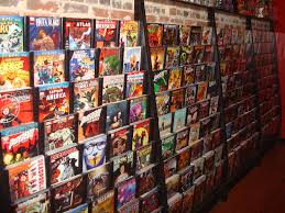 Comic display with a shelf up top to display collectables. | Store Shelving  | Pinterest | Shelves, Comic and Display