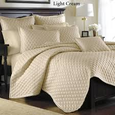 luxury quilted bedspreads with bed pillowcase and wood headboard also table lamp
