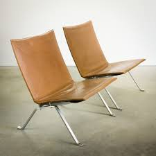 Pair Of Pk22 Lounge Chairs In Steel And Leather Poul Kjaerholm