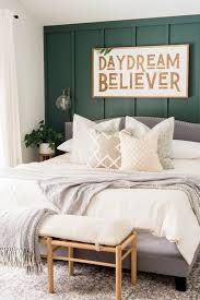 green accent wall in the bedroom