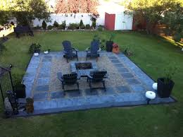 Charcoal slate patio stones with pea stone gravel. A square fire pit to  compliment the