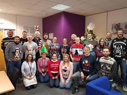 entire office decked. Our Caerphilly Office Associates, Decked In Christmas Sweaters And Decorations. - Ensono Entire