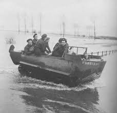 m29 c weasel amphibious transport military modelling british personel moving through a flooded saar river valley while laying wire one of the common handy jobs for weasels
