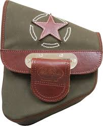 traditionally motorcycle saddlebags and seats are manufactured using leather and this is true with most of la rosa design s product line a few years ago