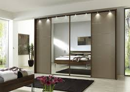 stylish track lighting. Black Rug For Contemporary Bedroom Plan With Modern Wardrobe Design Using Mirrored Sliding Doors And Stylish Track Lighting F