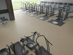 stacked rolled rubber flooring in a weight room