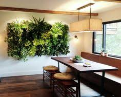 Indoor Vertical Garden by Brandon Pruett using lush ferns, lipstick plants  and pothos. http