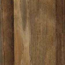strips of large natural banana leaves are hand pieced together then backed with lightweight cheesecloth to create a distressed wood plank look