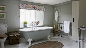 The Rough Plastered Walls Look Beautiful In This Grey Bathroom