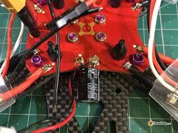 capacitors for noise filtering in mini quad oscar liang er capacitor on pdb in mini quad