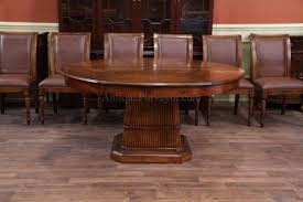66 inch round solid walnut dining table with leaves