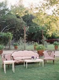 outdoor wedding furniture. french vintage theme wedding with light pink antique furniture and coffee table at outdoor o