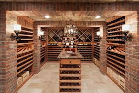 types of red wines inspiration for traditional wine cellar with lantern chandelier old iron sconce wine cellar entry door and light wood wine storage
