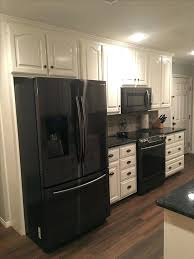 pictures of white kitchen cabinets with black appliances cabinet off white kitchen with black appliances h57 kitchen