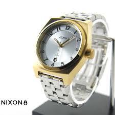 raiders rakuten global market nixon watch monopoly gold x2f nixon watch monopoly gold silver silver nixon the monopoly gold silver silver