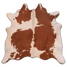 cowhide rug natural red brown white