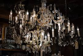 old crystal chandeliers in an antique by cara dolan for stocksy united