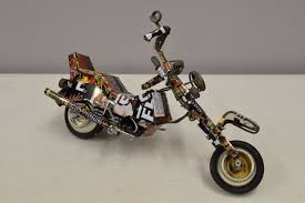 toy motorcycle african recycled nescafe tin can tanzania handmade