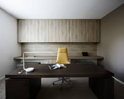 minimalist office design. perfect design large modern freestanding desk carpeted study room idea in melbourne with  beige walls for minimalist office design d
