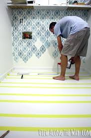 best faux wood laminate flooring how to paint vinyl laminate floors its easy and inexpensive