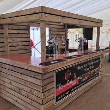 pallet bar with lights. this beautiful and precise pallet wood beverage bar is funky attractive. its lively the bright colorful lights are making it fit for any garden with
