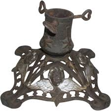 Large Christmas Tree Stand Germany Antique Cast Iron Christmas Tree Stand With Cherub Faces