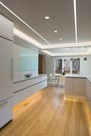 aurora square reveal wall wash and led softstrip make this modern kitchen design plete the lighting perfectly offsets the modern italian cabinetry