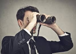 look out with binoculars