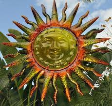 sun face with long spike wall decor
