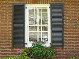 exterior shutters outdoor at in simple dark with faux brick panels for