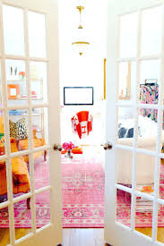 pink office decor. French Doors To Home Office With Bright Colors And Red Hermas Blanket Over Chair Pink Decor