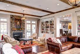 victorian hotel pendant victorian living room and area rug distressed leather sofa exposed beams exposed stone
