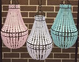 beaded chandelier beaded chandelier 4 styles elena wood bead chandelier pottery barn