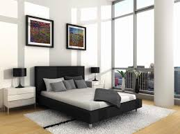 small apartment bedroom with glass wall and single bed frame in black combine with white bedding and side desk