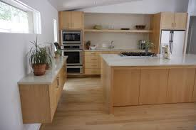 Custom Maple Kitchen Cabinets With Light Colored Quartz Counter Tops