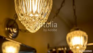 detail of a crystal style glass cover which adorns a hanging chain link swag style