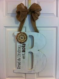 a43e10c9f8e6415c73cbed letter door hangers initial door hanger