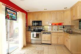 interior design um size spacious kitchen room with natty wooden cabinets and glossy countertop island near