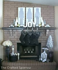 so i chose to paint the fireplace a light creamy white the same color of the kitchen cabinets i just painted that are at the other end of this family room