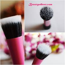 overall the real techniques stippling brush es in a pink and black packaging with 100 synthetic taklon bristles which are free