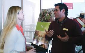 lisa mackey from ridgeway talks with old fort erie manager travis hill during the niagara parks summer job fair held saay at legends on the niagara