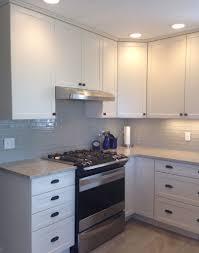art exhibition white shaker cabinets with quartz backsplash canterbury kitchen