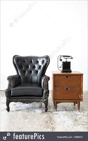 retro leather chair with telephone royalty free stock image