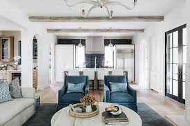 blue accent chairs with round white oak coffee table