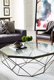 a geometric coffee table with a metal base and a geo glass tabletop will add a