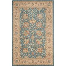 safavieh antiquity collection blue area rug 5x8 hand tufted wool in blue
