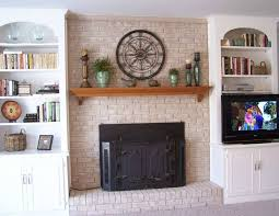 exciting brick fireplace decorating ideas with black covered fireplace also built in walls shelves plus wooden fireplace mantel shelves