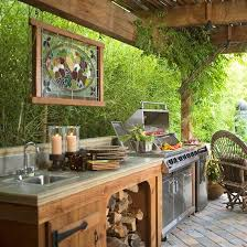 Love the idea of hanging a stained glass window in my outdoor room also love the idea of the grill and outside food prep